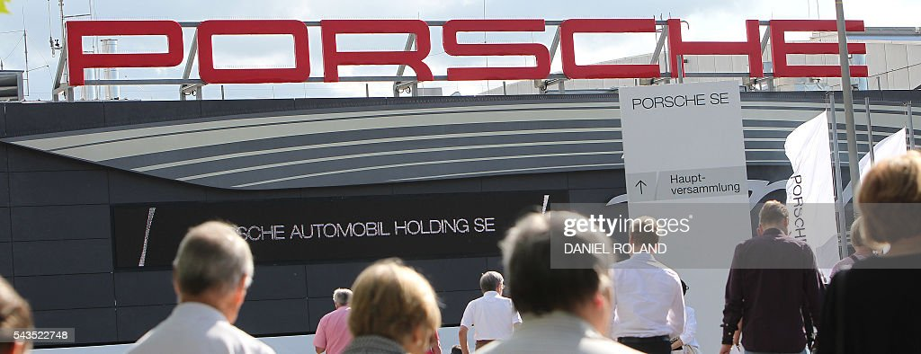 The logo of German company Porsche SE is pictured prior to the company's annual shareholder meeting at the Porsche Arena in Stuttgart, Germany, on June 29, 2016. / AFP / DANIEL
