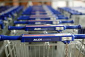 The logo of German discount supermarket giant Aldi is pictured on their trolleys on August 3 2010 at one of their outlets in Berlin AFP PHOTO /...