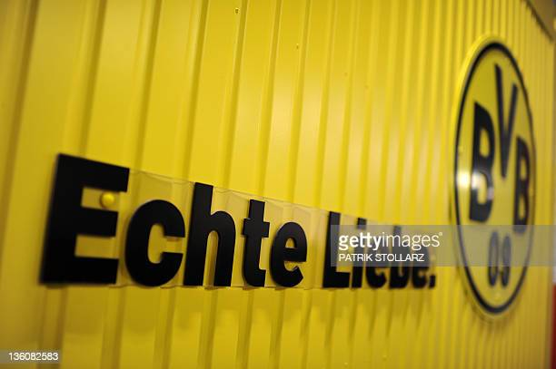 The logo of German first division football club Borussia Dortmund and the lettering 'True Love' is seen near the 'Borusseum' football museum in the...
