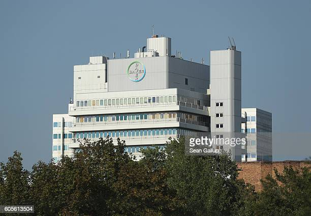 The logo of German pharmaceuticals and chemicals giant Bayer stands over Bayer corporate offices on September 14 2016 in Berlin Germany The company...