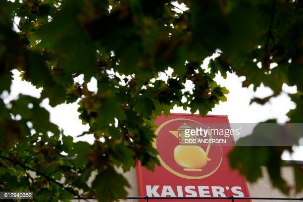 The logo of German retail chain Kaiser's of the Kaiser's Tengelmann group can be seen at a Kaiser's supermarket in Berlin on October 6 2016 A high...