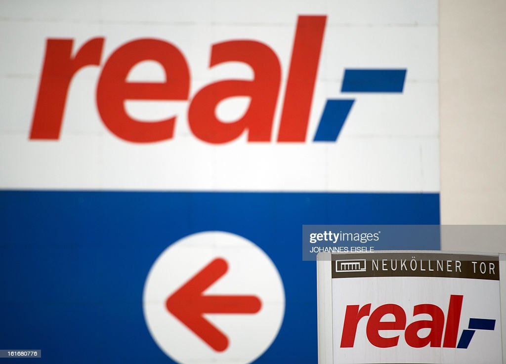 The logo of German supermarket chain 'real' is pictured on February 14, 2013 in Berlin, Germany. The German supermarket chain announced on February 14, 2013 that it has found traces of horse in frozen lasagne that it had pulled as a precautionary measure off the shelves last week. AFP PHOTO / JOHANNES EISELE