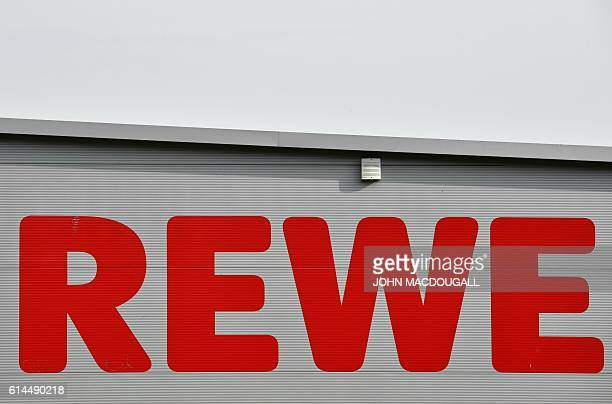 The logo of German supermarket chain Rewe is seen on October 14 2016 in Berlin After negociation talks between the Tengelmann group and potential...