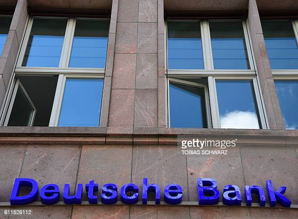 The logo of Germany's biggest lender Deutsche Bank is seen on a branch of the bank in Berlin's Mitte district on September 30 2016 Shares in Deutsche...