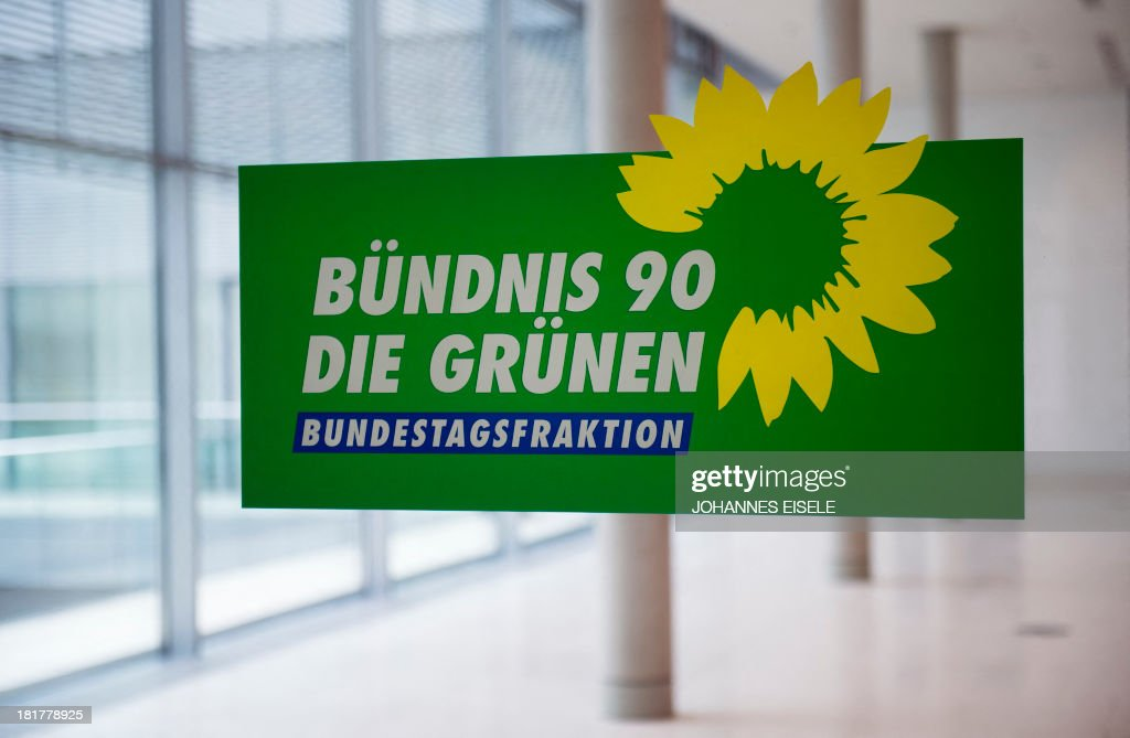 The logo of Germany's Green Party (Die Gruenen) is seen at the party's parliamentary group rooms at the Bundestag (lower house of parliament) in Berlin on September 25, 2013. EISELE