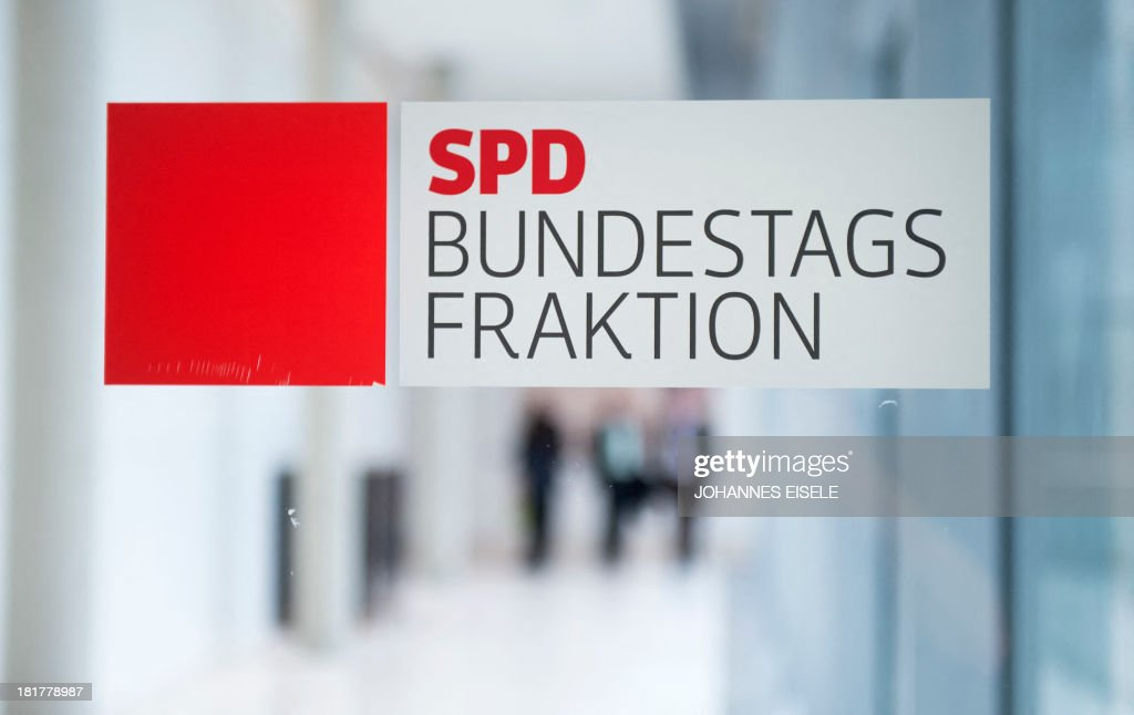 The logo of Germany's social democratic SPD party is seen at the party's parliamentary group rooms at the Bundestag (lower house of parliament) in Berlin on September 25, 2013. EISELE