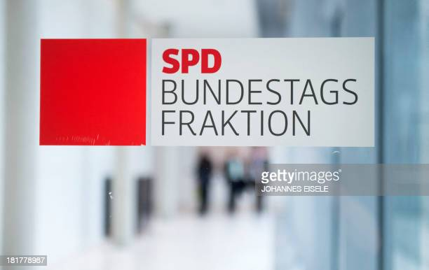 The logo of Germany's social democratic SPD party is seen at the party's parliamentary group rooms at the Bundestag in Berlin on September 25 2013...