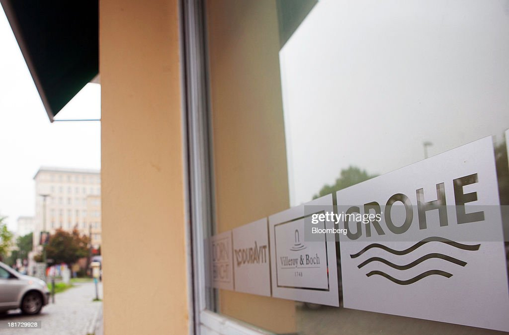 The logo of Grohe Group sits on display on the window of a bathroom store in Berlin, Germany, on Tuesday, Sept. 24, 2013. Lixil Corp., a Japanese toilet maker, is in advanced talks to buy German bathroom-fixtures company Grohe Group for more than 3 billion euros ($4 billion), according to people with knowledge of the matter. Photographer: Krisztian Bocsi/Bloomberg via Getty Images