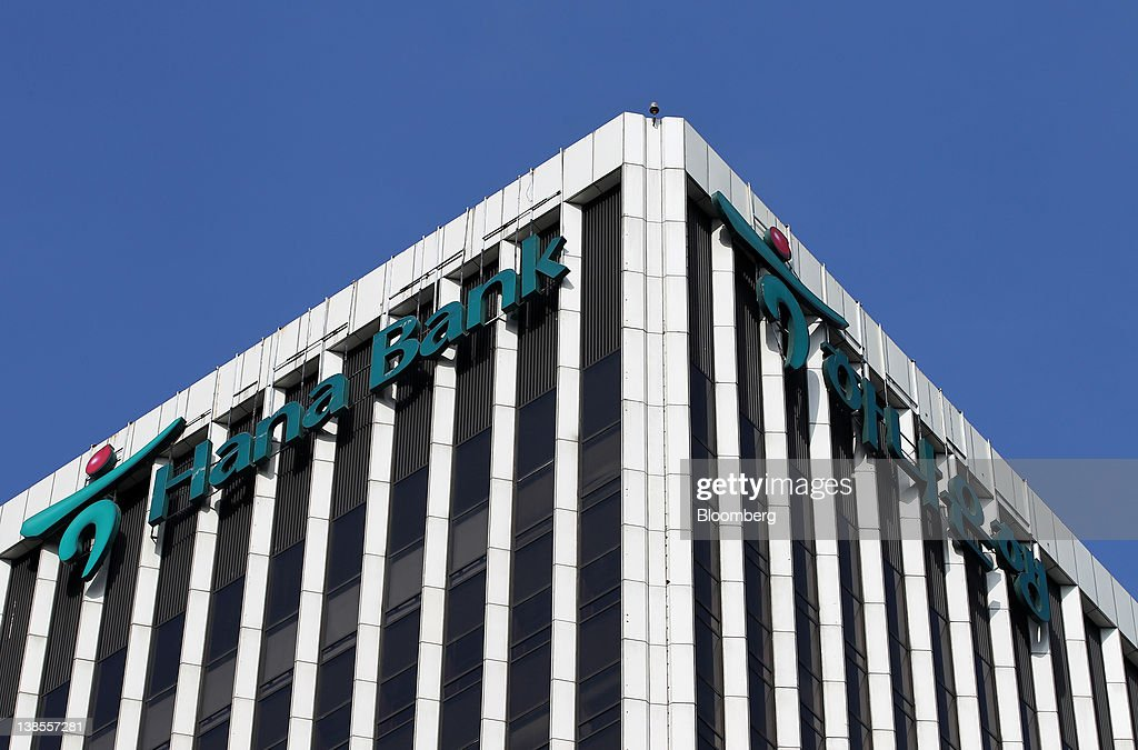 The logo of Hana Bank is displayed at the bank's headquarters in Seoul, South Korea, on Thursday, Feb. 9, 2012. Hana Financial Group Inc. completed its 4.4 trillion won ($3.9 billion) purchase of Korea Exchange Bank from Lone Star Funds and Export Import Bank of Korea, allowing Hana to narrow a gap with rivals and the U.S. fund to exit the investment after eight years. Photographer: SeongJoon Cho/Bloomberg via Getty Images