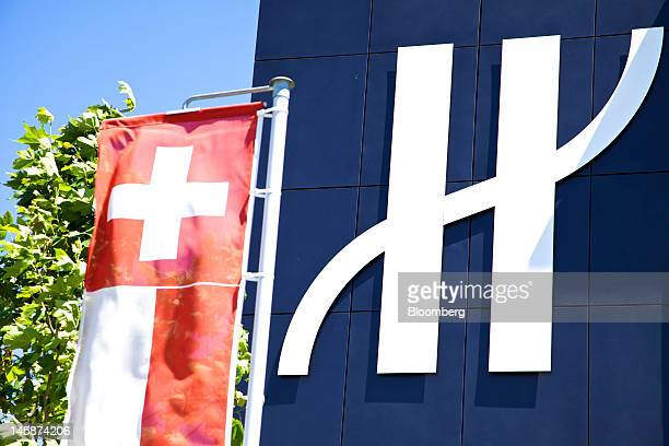 The logo of Hublot SA hangs outside the company's headquarters in Nyon Switzerland on Tuesday June 5 2012 Hublot SA Chairman JeanClaude Biver said...
