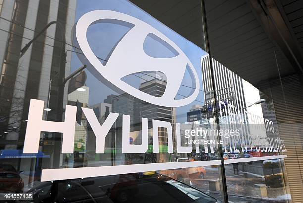The logo of Hyundai Motor is seen on the glass door at its branch in Seoul on January 23 2014 Hyundai Motor reported a 125 percent rise in...