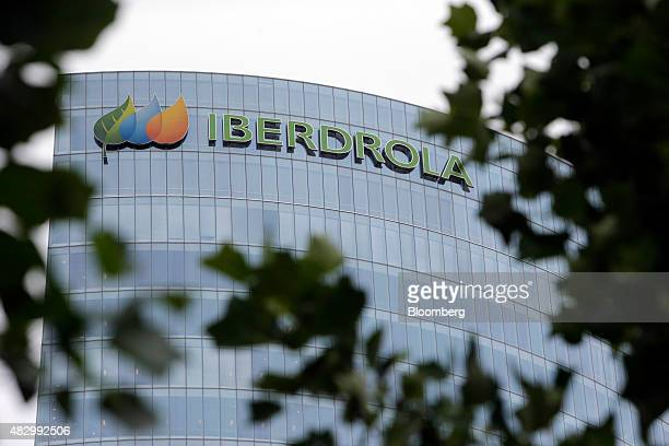 The logo of Iberdrola sits on display outside the headquarters of Iberdrola SA in Bilbao Spain on Tuesday Aug 4 2015 Iberdrola SA Spain's largest...