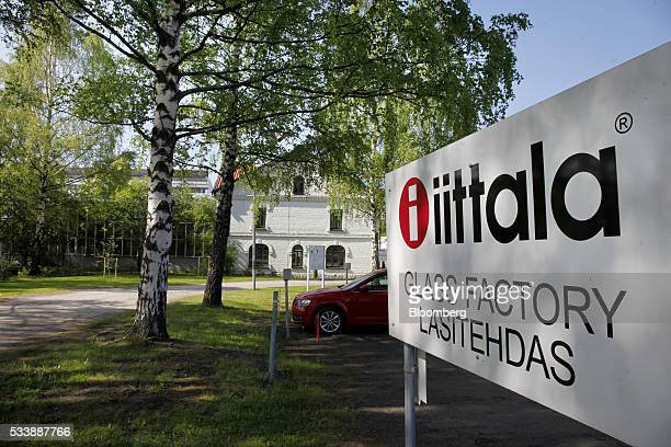 The logo of Iittala sits on a sign at the entrance to the Iittala Oyj glass factory operated by Fiskars Oyj in Hameenlinna Finland on Friday May 20...