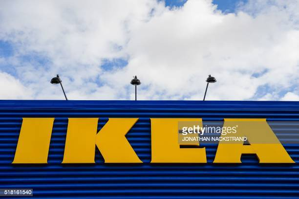 The logo of IKEA is pictured at the Europe's biggest Ikea store in Kungens Kurva southwest of Stockholm on March 30 2016 Ikea founder Ingvar Kamprad...