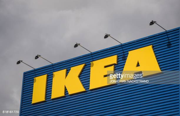 The logo of IKEA is pictured outside Europe's biggest Ikea store in Kungens Kurva southwest of Stockholm on March 30 2016 Ikea founder Ingvar Kamprad...