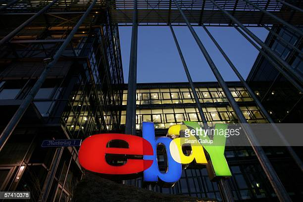 The logo of Internet auction house eBay glows at the company's German headquarters April 24 2006 in Kleinmachnow Germany Germany is among eBay's...