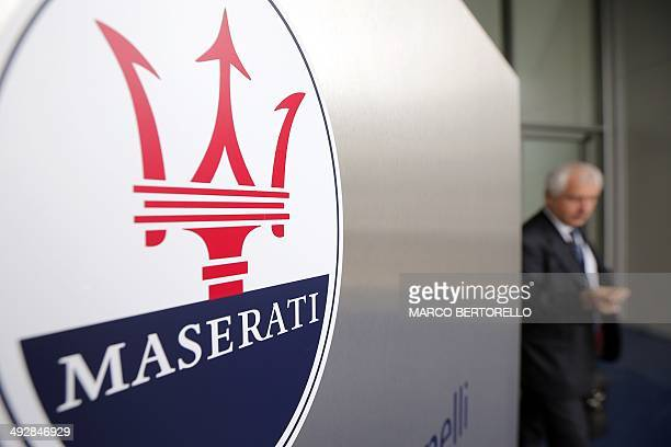 The logo of Italian luxury car manufacturer Maserati is seen at the entrance of a Maserati plant on May 22 2014 in Grugliasco near Turin The Italian...