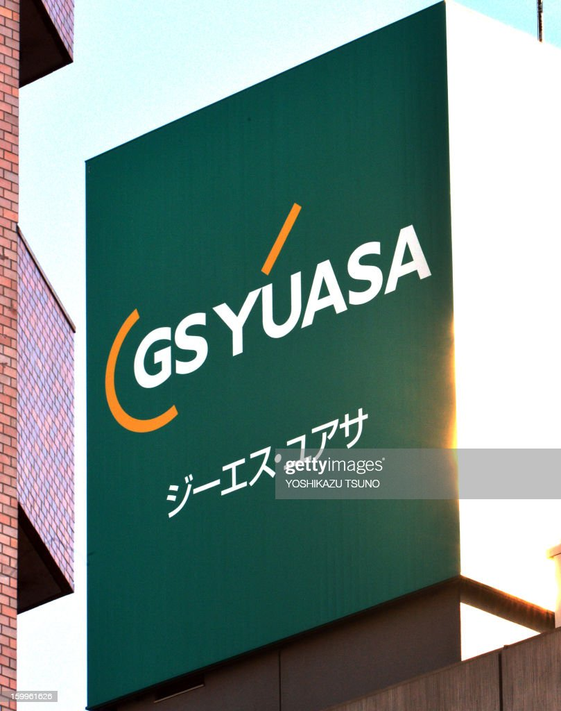 The logo of Japanese battery maker GS Yuasa is displayed at a company's offices in Tokyo on January 24, 2013. Officials probing the emergency landing of a Boeing Dreamliner said on January 24 they will dismantle its battery unit, after the investigation found no evidence of a sudden surge in voltage. AFP PHOTO / Yoshikazu TSUNO