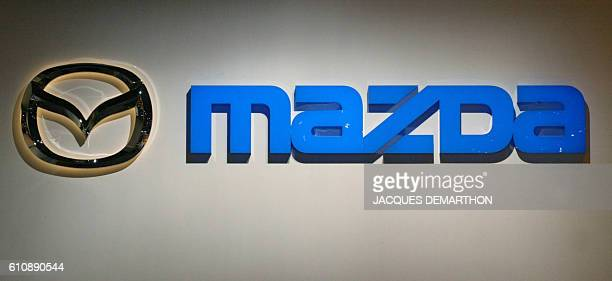 The logo of Japanese car maker Mazda is pictured 27 September 2002 at the Paris Auto Show The exhibition will open officially 28 September and will...