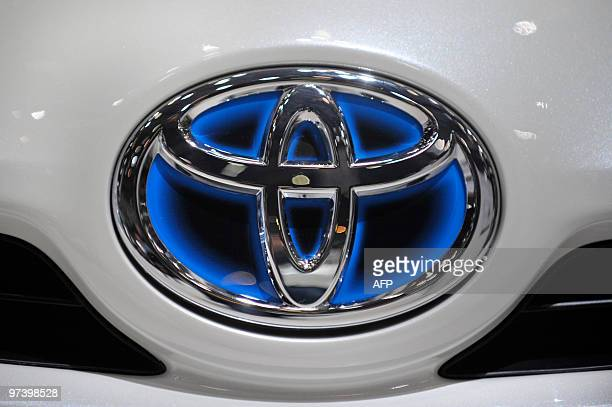 The logo of Japanese car manufacturer Toyota can be seen on a Toyota Prius at the 80th Geneva International Motor Show at Palexpo in Geneva on March...
