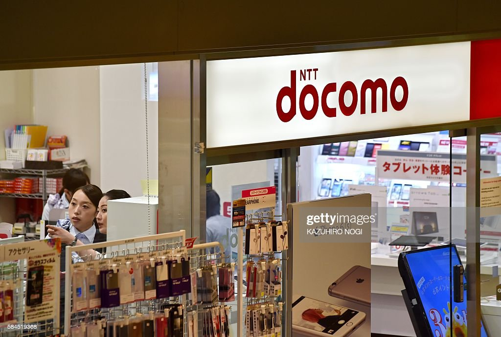 The logo of Japanese mobile giant NTT Docomo is displayed at a shop in Tokyo on July 29 2016 Japanese leader in mobile telecommunications NTT Docomo...