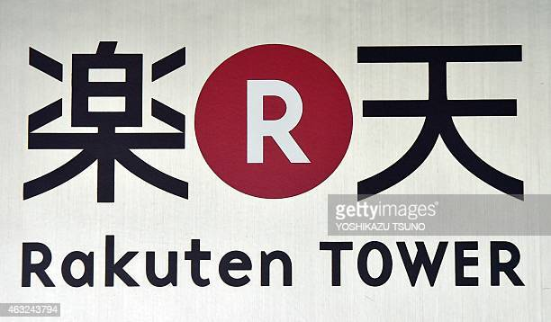 The logo of Japan's ecommerce giant Rakuten is displayed at the company headquarters in Tokyo on February 12 2015 Rakuten group posted revenue of 498...