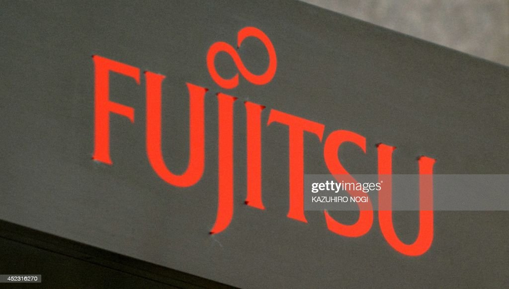 The logo of Japan's major electronics firm Fujitsu Ltd. is displayed at its head office in Tokyo on July 18, 2014. Fujitsu plans to pull out of the semiconductor business and sell a pair of chip-manufacturing factories to Taiwanese and US firms over the new few years, a report said July 18.