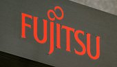 The logo of Japan's major electronics firm Fujitsu Ltd is displayed at its head office in Tokyo on July 18 2014 Fujitsu plans to pull out of the...