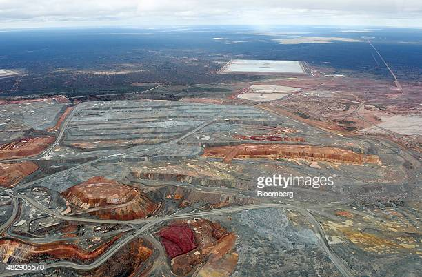 The logo of Kalgoorlie Consolidated Gold Mines Ltd is marked in the waste dump at the Fimiston Open Pit mine known as the Super Pit in this aerial...