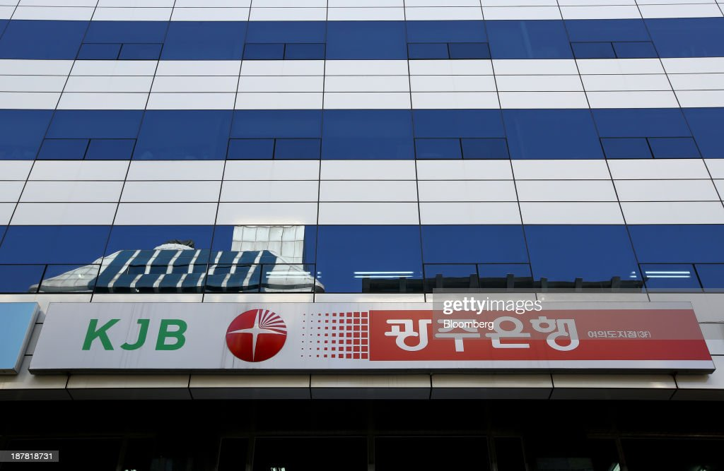 The logo of Kwangju Bank, a unit of Woori Finance Holdings Co., is displayed outside one of the bank's branches in Seoul, South Korea, on Tuesday, Nov. 12, 2013. Woori Finance Holdings is scheduled to report third-quarter results on Nov. 14. Photographer: SeongJoon Cho/Bloomberg via Getty Images