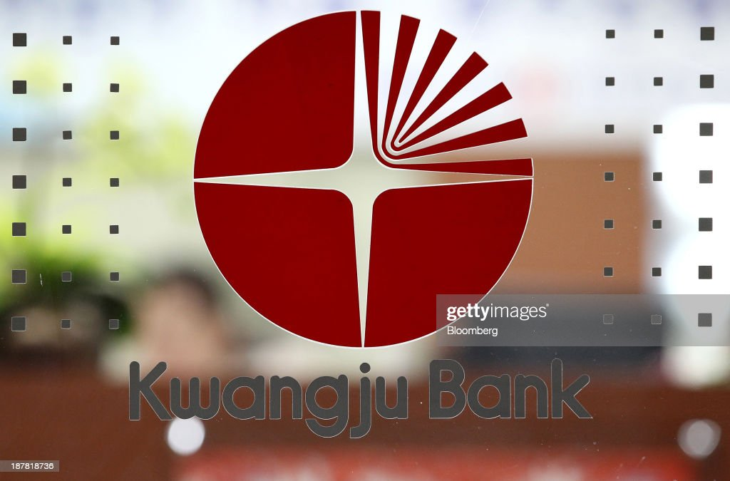 The logo of Kwangju Bank, a unit of Woori Finance Holdings Co., is displayed inside one of the bank's branches in Seoul, South Korea, on Tuesday, Nov. 12, 2013. Woori Finance Holdings is scheduled to report third-quarter results on Nov. 14. Photographer: SeongJoon Cho/Bloomberg via Getty Images