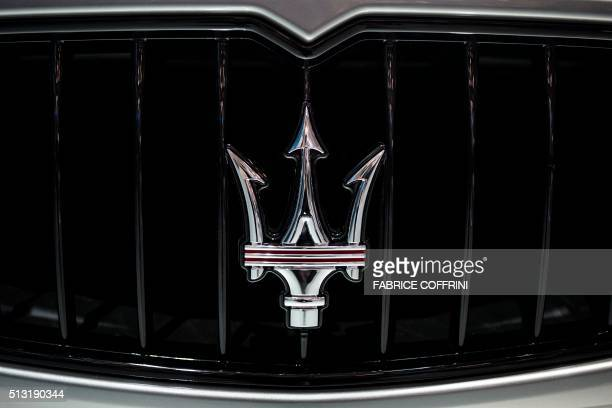 The logo of Maserati is seen on a car at the stand of Italian carmaker during the press day of the Geneva Motor Show on March 1 2016 in Geneva / AFP...