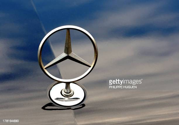 The logo of Mercedes Benz car of German auto giant Daimler is pictured on August 27 2013 in Bailleul France's Conseil d'Etat will discuss on August...