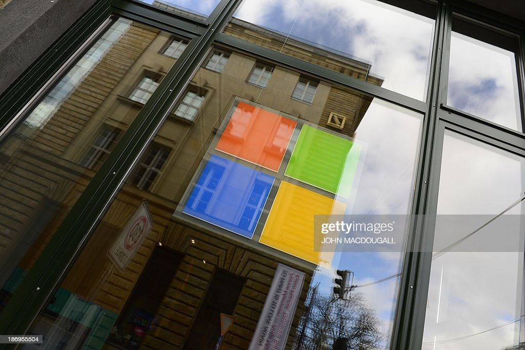 The logo of Microsoft can be seen on a window of the 'Microsoft Berlin' venue on November 5, 2013 in Berlin. The building includes among others a 'Digital Eatery', a briefing center and a start-up center and aims to become the company's platform in Europe for networking and dialogue.