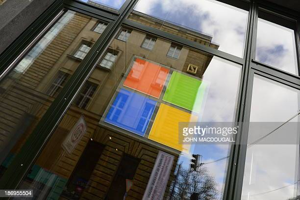 The logo of Microsoft can be seen on a window of the 'Microsoft Berlin' venue on November 5 2013 in Berlin The building includes among others a...