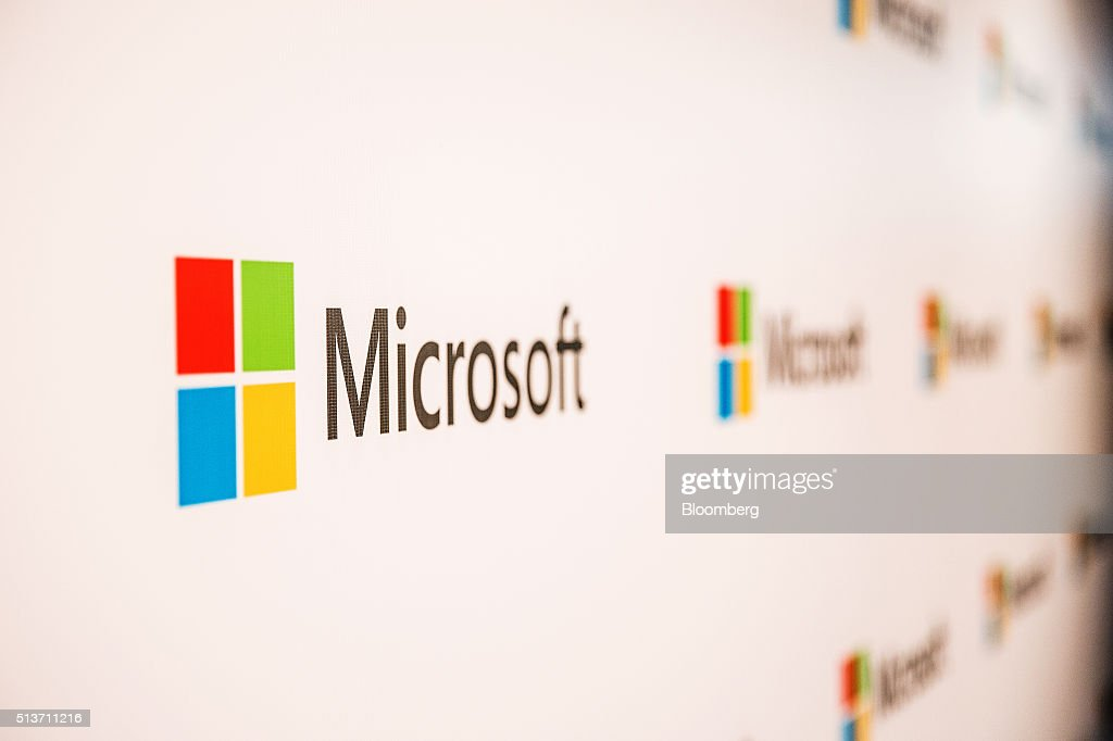The logo of Microsoft Corp. is displayed at the company's Office and Experience Center in Hong Kong, China, on Friday, March 4, 2016. Microsoft is rolling out a new service for its Windows 10 operating system to help large businesses detect hackers, security threats and unusual behavior on their networks, rivaling companies like FireEye Inc. and Symantec Corp. Photographer: Billy H.C. Kwok/Bloomberg via Getty Images