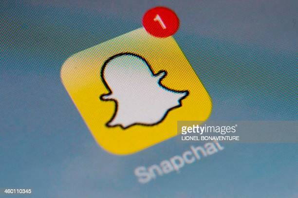 The logo of mobile app 'Snapchat' is displayed on a tablet on January 2 2014 in Paris Hackers broke into Snapchat the hugely popular mobile app...