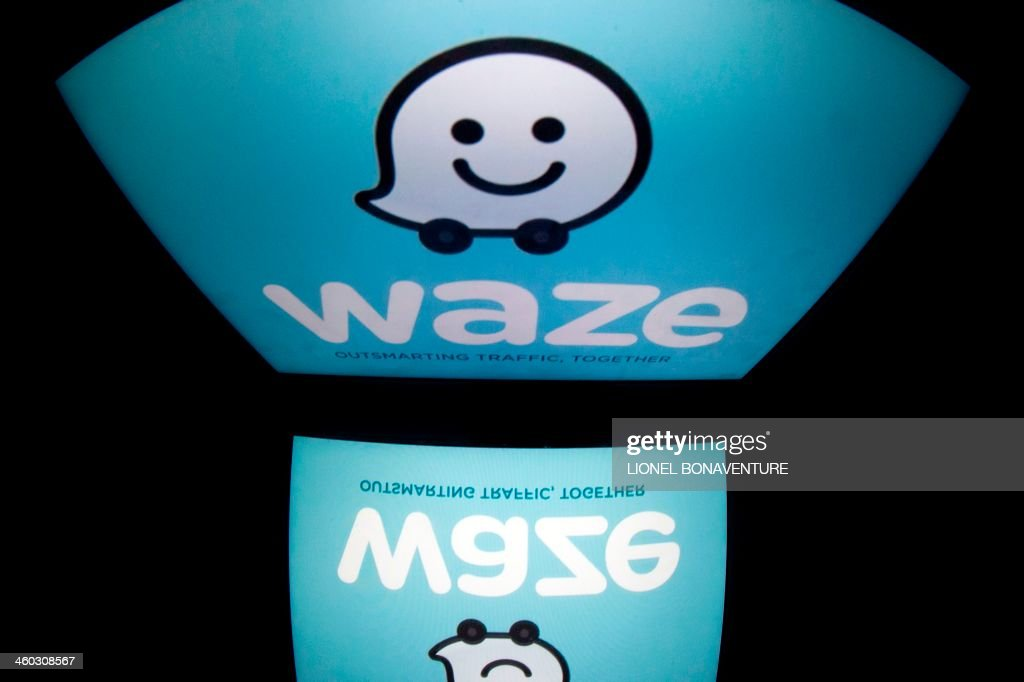 The logo of mobile app 'Waze' is displayed on a tablet on January 2, 2014 in Paris. Waze is a community-based traffic and navigation app.