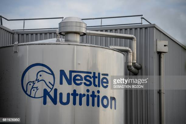 The logo of Nestlé is viewed outside the baby food production plant in Arches on May 11 2017 / AFP PHOTO / Sebastien Bozon