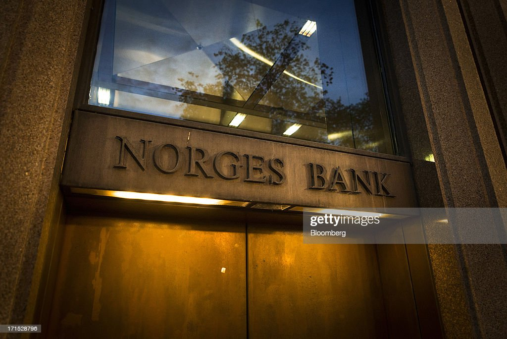 The logo of Norges Bank, Norway's central bank, sits outside the headquarters in Oslo, Norway, on Wednesday, June 26, 2013. The Norwegian and Swedish currencies added to last week's slump triggered by Norway's central bank unexpectedly lowering its outlook for interest rate. Photographer: Kristian Helgesen/Bloomberg via Getty Images