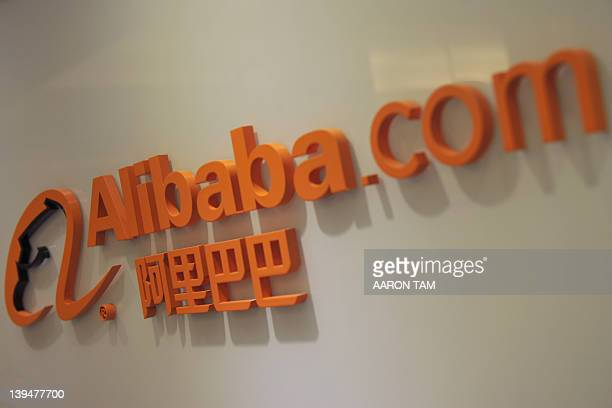 The logo of online shopping portal Alibabacom is seen near its office in Hong Kong on February 22 2012 The share price of Chinese online shopping...