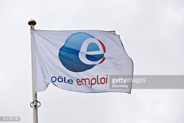 The logo of Pole Emploi the French national employment agency sits on a flag flying outside a job center in Montpellier France on Tuesday Feb 25 2014...