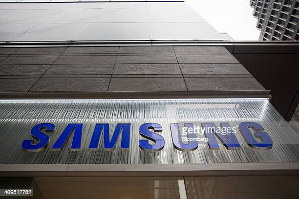 The logo of Samsung Electronics Co is displayed outside a Samsung Partnershop retail store in Hong Kong China on Friday April 10 2015 Samsung expects...