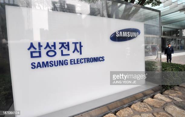 The logo of Samsung Electronics is displayed outside their headquarters in Seoul on November 6 2013 Samsung Electronics promised better shareholder...
