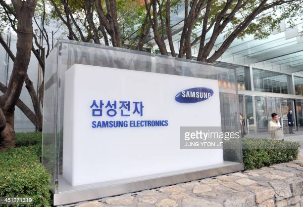 The logo of Samsung Electronics is seen outside the company's headquarters in Seoul on November 22 2013 A US federal jury on November 21 ordered...