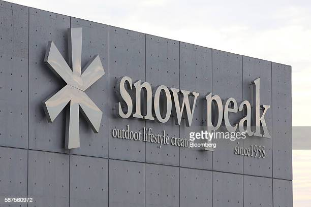 The logo of Snow Peak Inc is displayed atop the company's headquarters in Sanjo Niigata Prefecture Japan on Tuesday Aug 2 2016 Snow Peak which makes...