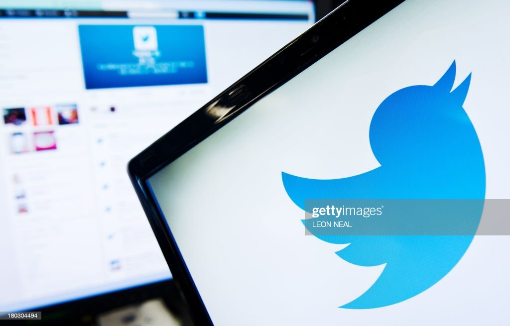 The logo of social networking website 'Twitter' is displayed on a computer screen in London on September 11 2013 AFP PHOTO / LEON NEAL