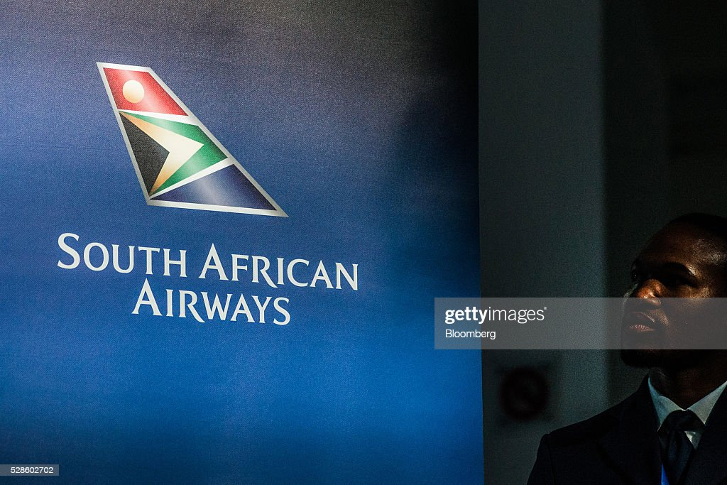 The logo of South African Airways (SAA) sits on a banner during a visit by Jacob Zuma, South Africa's president, to the company's offices in Johannesburg, South Africa, on Friday, May 6, 2016. It appears to be just a matter of time before South Africa's credit rating is cut to junk. Photographer: Waldo Swiegers/Bloomberg via Getty Images
