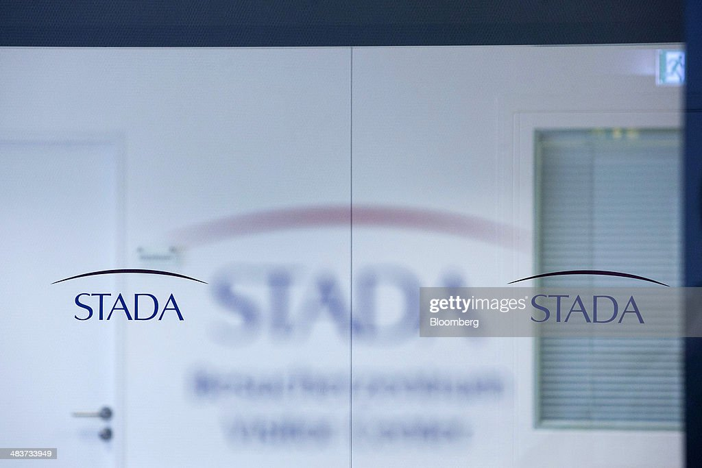 The logo of Stada Arzneimittel AG sits on a window at the factory of Germany's biggest maker of generic drugs, in Bad Vilbel, Germany, on Wednesday, April 9, 2014. Last month Stada Arzneimittel AG climbed 2.7 percent after Deutsche Bank AG upgraded its rating on the maker of generic drugs. Photographer: Krisztian Bocsi/Bloomberg via Getty Images