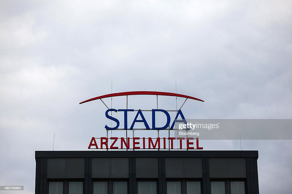 The logo of Stada Arzneimittel AG sits on sign at the factory of Germany's biggest maker of generic drugs, in Bad Vilbel, Germany, on Wednesday, April 9, 2014. Last month Stada Arzneimittel AG climbed 2.7 percent after Deutsche Bank AG upgraded its rating on the maker of generic drugs. Photographer: Krisztian Bocsi/Bloomberg via Getty Images